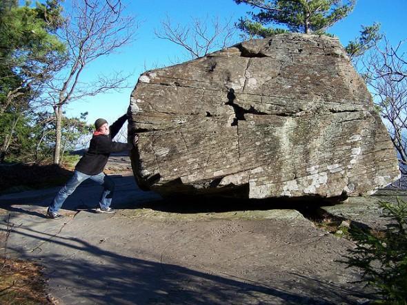 pushing a boulder
